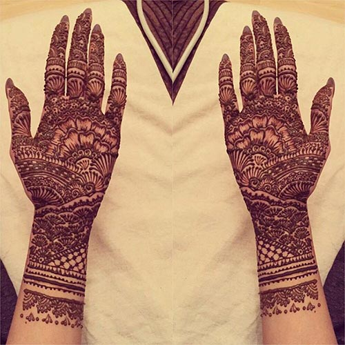 heavy floral bridal mehndi design
