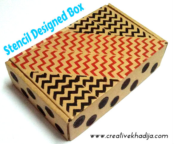 decorated gift box with stencils and acrylic paints