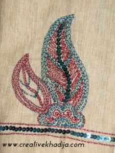 zardosi embroidery on shirt on arm